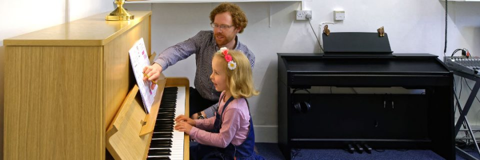 piano-lesson-with-student